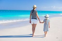 Back view of happy mother and little daughter at Royalty Free Stock Images