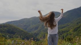 Back view of happy teenage girl on top of mountains. stock video footage