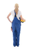 Back view of happy woman in blue builder uniform holding yellow Stock Image