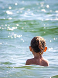 Back view head of child girl in water Royalty Free Stock Image