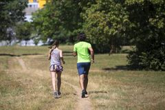 Healthy, fit and  sportive couple running in park Stock Photos