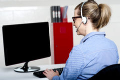 Back view of help desk lady working Royalty Free Stock Images