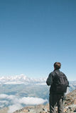 Back view of hiker man contemplating the massif of Montblanc. Royalty Free Stock Image