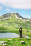 Back view of hiker woman contemplating beautiful Alps landscape. royalty free stock photography