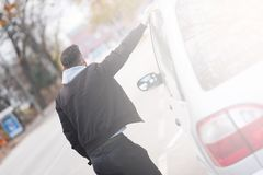 Back view of a hipster man standing next to a car Royalty Free Stock Photo