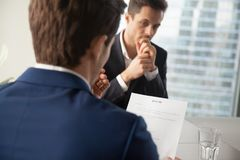 Hiring manager reading job candidates resume royalty free stock photos