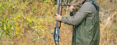 Back view of hunter carry classic rifle shotgu in forest f stock images