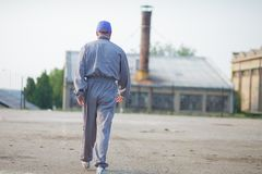Back view of an industrial manufacturing factory worker. Industrial manufacturing factory worker going to work royalty free stock image
