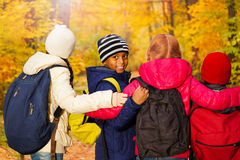 Back view of international kids standing close Royalty Free Stock Photo