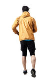 Back view of jogger in jacket running Royalty Free Stock Photos