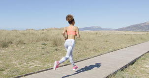 Back view of jogging woman Royalty Free Stock Images