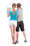 Back view journey of the young couple looking at the map Royalty Free Stock Photos
