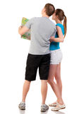 Back view journey of the young couple looking at the map. Royalty Free Stock Images