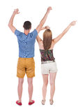 Back view of  joyful couple celebrating victory hands up. Stock Photo