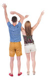 Back view of  joyful couple celebrating victory hands up. Royalty Free Stock Photography