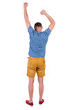 Back view of  joyful man celebrating victory hands up. Royalty Free Stock Photography
