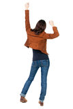 Back view of  joyful woman celebrating victory hands up Royalty Free Stock Photo