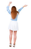 Back view of  joyful woman celebrating victory hands up. Stock Images