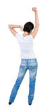 Back view of  joyful woman celebrating victory hands up. Royalty Free Stock Photo