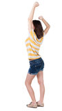 Back view of  joyful woman celebrating victory hands up Stock Photography