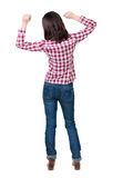 Back view of  joyful woman celebrating victory hands up Stock Image