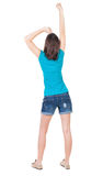 Back view of  joyful woman celebrating victory hands up Royalty Free Stock Photos