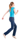 Back view of jumping  woman  in  jeans Royalty Free Stock Photography
