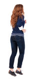 Back view of jumping  woman  in  jeans. Royalty Free Stock Images
