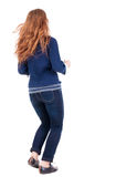 Back view of jumping  woman  in  jeans Stock Photo