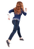 Back view of jumping  woman  in  jeans. Stock Image