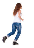 Back view of jumping  woman  in  jeans. Royalty Free Stock Photo