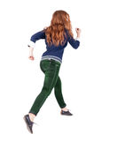 Back view of jumping  woman  in  jeans. Royalty Free Stock Photos