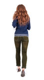 Back view of jumping  woman  in  jeans. Stock Photo