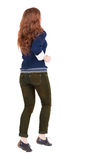 Back view of jumping  woman  in  jeans. Stock Images