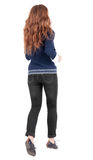 Back view of jumping  woman  in  jeans. Stock Photography