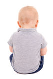 Back view of little baby boy sitting isolated on white Stock Photo