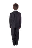 Back view of little boy in business suit isolated on white. Background Royalty Free Stock Photography