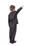 Back view of little boy in business suit pointing at something i Royalty Free Stock Photography