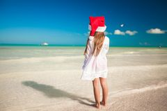 Back view of Little cute girl in red hat santa Royalty Free Stock Photography