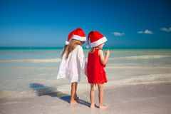 Back view of Little cute girls in Christmas hats Royalty Free Stock Photography