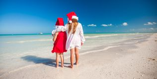 Back view of Little cute girls in Christmas hats Stock Image
