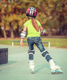 Back view of little girl in helmet Royalty Free Stock Images