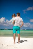 Back view of little girl hugging with dad on the Royalty Free Stock Images