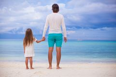 Back view of little girl hugging with dad on the Royalty Free Stock Image
