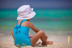Back view of little girl in nice swimsuit playing Royalty Free Stock Photo
