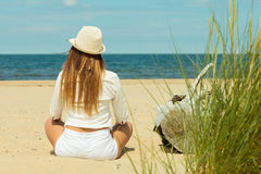 Back view of long haired woman on beach. royalty free stock photography
