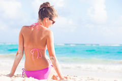 Back view of long haired woman in bikini on Stock Photos