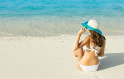 Back view of long haired young woman in swimsuit Royalty Free Stock Image