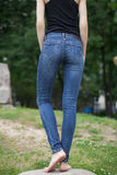 Back view of a long women legs posing with jeans Stock Photo