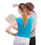 Back view journey of the young couple looking at the map Stock Photography